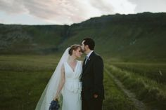 Bride and Groom in a field. Destination wedding in Iceland at Hotel Budir.