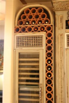 wine storage idea with terra cotta clay drainage pipe sections.  Salvaged pipes available at Estate ReSale & ReDesign, Bonita Springs, FL $3.99 each.  Salvage, Recycle, Repurpose, upcycle!