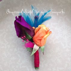 Colorful silk rose corsage in orange and purple. Can become a boutonniere. Customizable on Etsy, $15.00