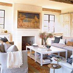 This muted color scheme was inspired by the painting over the fireplace.