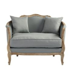 With its perfect proportions and cushioned, wrap-around back, this French settee creates a cozy retreat for a bedroom or sitting room. Limed finished, solid oak frame .
