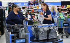 A cashier helps a customer at Walmart on E. Capitol Drive in Milwaukee. In the U.S. and Wisconsin, cashier is the No. 3 most in-demand occupation, according to U.S. Labor Department data, but like most job openings these days, the position is a low-paying one.
