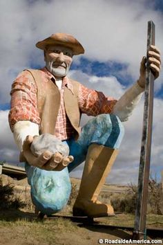 Giant Prospector. Washoe Valley, Nevada. 18 - foot tall. Oversize chunk of faux gold in his hand. Located between Reno and Carson City.