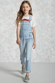 Forever 21 Girls - A pair of denim overalls featuring a faded wash, front bib pocket, adjustable shoulder straps, slanted front pockets, back patch pockets, side buttons, a side zipper, distressed knees, and whiskering.