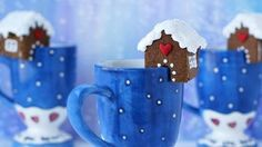 These mini gingerbread houses perch on the edge of your mug; looks like something I would do -  tedious and labor intensive.