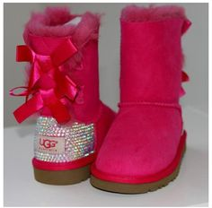 Pink sparkly uggs with bows on the back love these uggs