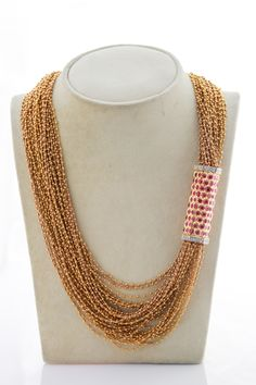 gold beads,rubies,diamonds spectacular and hand made