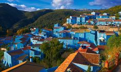Spanish village painted blue for PR stunt to becoe Smurf theme park