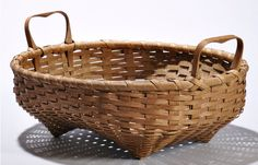 """Skinner's - The Shaker Collection of Erhart Muller, Auction 2898M. June 4, 2016. Lot: 161.  Estimate: $200-300.  Realized: $800.  Description:  Oval Handled Shaker Basket, 20th century, woven splint with tapered bottom formed with four pointed feet, bentwood handles, marked """"B"""" within a circle on the bottom, ht. 5 1/4, wd. 16 1/4, dp. 12 3/4 in."""