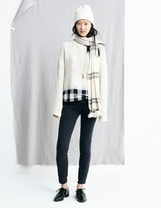 madewell fall 2015 #fallmadewell. cream sweater, black skinny jeans, lace-up oxfords, scarf with pom-poms.