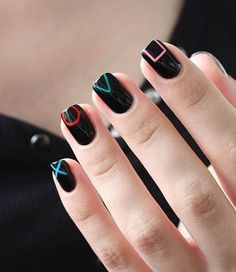 Playstation controller inspired black nail art design. Perfect nail art design for short nails as well as gamer geeks that also want to look fashionable while playing.