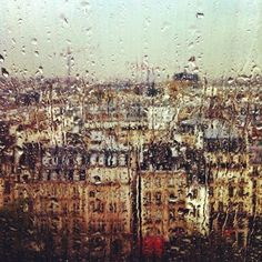 Paris in the rain through the window