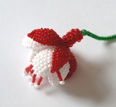How to make a flower fuchsia.  Good pix but needs translation. #seed #bead #tutorial
