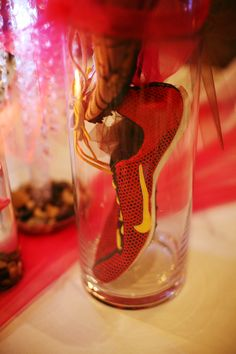 Since we both ran in college, we used our shoes as centerpieces, one of my shoes tied to his shoe in a vase.