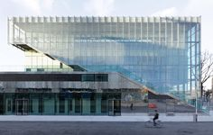 A layer of glass louvres wraps this Paris sports centre by Dietmar Feichtinger Architectes, forming a semi-transparent facade Architecture Design, Contemporary Architecture, Amazing Architecture, Pont Paris, Sport Hall, Glass Facades, Paris Ville, Concert Hall, Modern Buildings