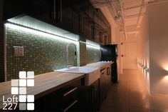 """New York City's most intimate High-Tech Loft Space: Cocktails for 100, Meetings for 70, Dinners for 50. Special Events, Executive Dinners, Film Screenings, Location Shoots, Photography, + Production in this iconic Fashion District space. 11' ceilings, polished concrete floors, beige marble wall, black glass wall, alaskan cedar wood barn doors, halogen + intelligent LED-RGB lighting.15' Retractible Movie Screen, 50"""" TV Screen, 32"""" TV + Surround Sound. Full Kitchen + Bathroom. info@loft227.com"""