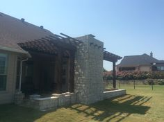 Beautiful Outdoor Living Area installed by GroundScape in Fort Worth, TX. Complete with Outdoor Fireplace, cedar pergola, flagstone patio, Kitchen and entertainment area. Please call for a consultation for your own outdoor living area. Cedar Pergola, Building A Pergola, Flagstone Patio, Landscaping Company, Outdoor Living Areas, Patio Kitchen, Entertainment Area, Fire, Arbors