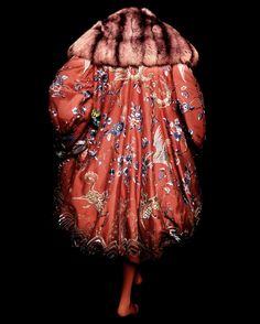 House of Dior (French, founded 1947). John Galliano (British, born Gibraltar, 1960). Evening coat, autumn/winter 1998–99 haute couture. Red-orange silk jacquard embroidered with polychrome silk thread and trimmed with red-orange sable fur. Courtesy of Christian Dior Couture | Photography © Platon #ChinaLookingGlass #AsianArt100