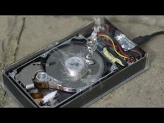 How a Hard Drive works in Slow Motion - The Slow Mo Guys  Cómo funciona un disco duro, miralo en slow motion