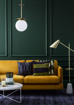With current autumn/winter trends including colour blocking, emerald green and the use of sumptuous velvet, we're keen to brighten up our homes in any way possible, and with the darker days, there's no better time than to make a feature of your lighting. (Photo: Debenhams) #lights #livingroom #interiordesign #velvet