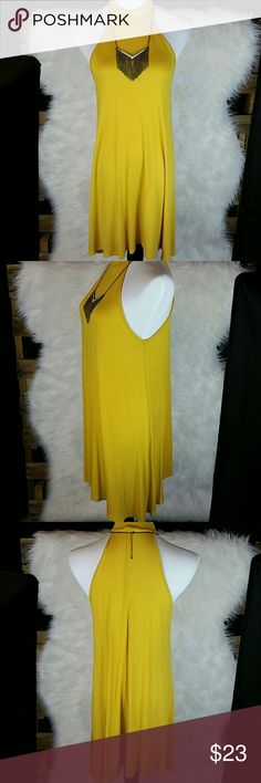 CLEARANCE= Trapeze Style Dress ~Beautiful gold color ~Perfect Summer Dress  ~See last picture for fabric  ~NO TRADES  ~REASONABLE OFFERS ACCEPTED   Manequin measurements : Bust:35 1/2 Waist:27 Hips:34 1/2 Dresses Midi
