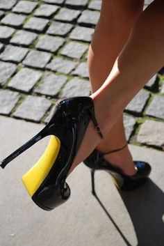 "Black and yellow heels. I dont like the word ""high"" in front of heels sooo its just ""heels"" Ladies!"