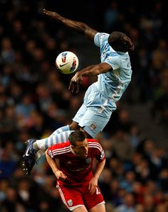 Manchester City's Micah Richards, right, challenges West Bromwich Albion's Nicky Shorey during their English Premier League soccer match at the Etihad Stadium in Manchester, northern England. (Reuters)