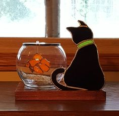 What's for dinner? Cat and fish in bowl stained glass by Michele Hubble, Starlight Glassworks