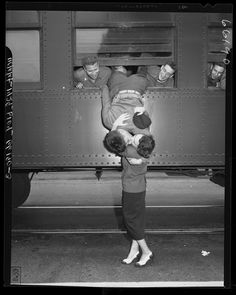 California National Guardsman hanging out window of train, kissing his wife good-bye, 1950 {adorable picture!}