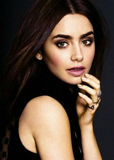 I absolutely love the plums. Beautiful pigments. Lily Collins is blessed with beautiful eyebrows.