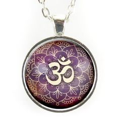 "The Purple Om Necklace is the perfect accessory for Yoga enthusiast and more. Adorn yourself with the sacred mantra as a reminder to be present and stay zen. - Pendant size: 1"" inch (25 mm) - Chain le"