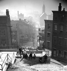 Morning in Over the Rhine,shot 11-16-1941 by Nelson Ronsheim on Isopan at F-8, 1/25 -A. Looking down Main St. from just above Seitz St