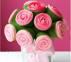 How about making this cupcake bouquet centerpiece. Use organic and cage free ingredients for the greenest version!