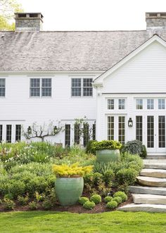 Love the oversized green planters mixed in with the landscaping!