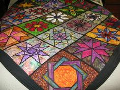A 2003 paper pieced stained glass flower quit