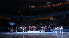 (L-R) Silver medalists team Canada, gold medalists team Russia and bronze medalists team USA pose on the podium during the flower ceremony for the Team Figure Skating Overall during day two of the Sochi 2014 Winter Olympics at Iceberg Skating Palace on February 9, 2014 in Sochi, Russia.