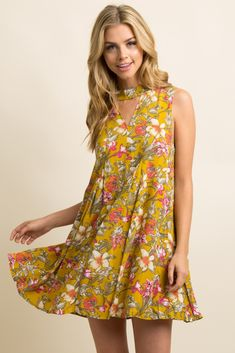 6dd3428ab2 Floral print sleeveless dress. Front and back cutouts. Pleat details. High  neckline with