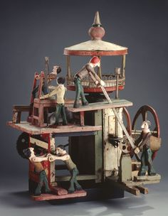 Folk art: The World of Work, ca. 1940. Carved and painted metal gears and metal crank.