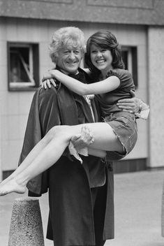 Doctor Who actor John Pertwee and an awful lot of Elisabeth Sladen's legs in a promotional image taken during filming of Sladen's first serial as the Doctor's companion, United Kingdom, 1973, photograph by Michael Webb.