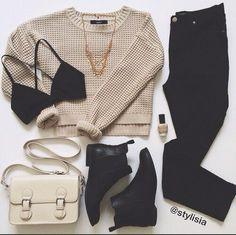 Oatmeal sweater, black bralette, black jeans, black ankle boots