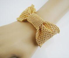 #Etsyjewelry #seedbeadjewelry #prangdesigns #bowbracet Bow cuff bracelet seed beads bracelet handcrafted by PrangDesigns.etsy.com