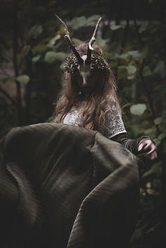 She hides in the forest, running wild and free.