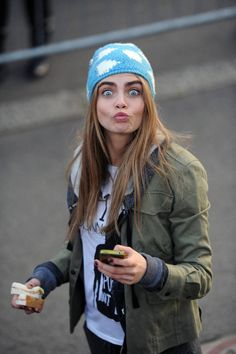 knit cap, graphic top, army jacket