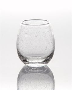 St. Remy Stemless Wine  Glasses are hand blown capturing tiny bubbles in the glass. Each glass is a one of a kind creation!