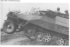 A SdKfz 251/7-1 assault engineer version with it assault bridge ramps mounted on the vehicle upper sides.