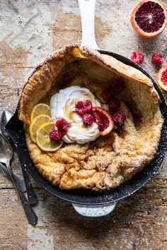 Whole Wheat Dutch Baby with Meyer Lemon Whipped Ricotta.basically a giant pancake baked in a skillet, hinted throughout with vanilla and sweet lemon, and topped with a delicious fresh Meyer lemon whipped ricotta. Brunch Dishes, Brunch Recipes, Breakfast Recipes, Dessert Recipes, Desserts, Yummy Recipes, Bakery Recipes, Baked Pancakes, Pancakes And Waffles