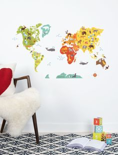 Petit Collage's adorable World Map Wall Decal is a bright and colorful way to make geography fun. Little ones will love the animal illustrations.
