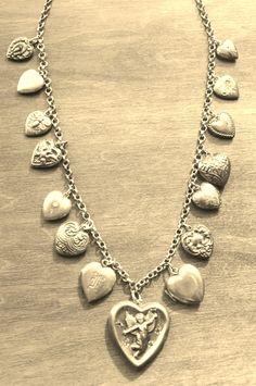 "Antique Sterling Victorian Charm NECKLACE Repousse Hearts Lg CHERUB Locket 15 Antique Hearts Red Enamel Heart  24"" Chain TT Team. $725.00, via Etsy."