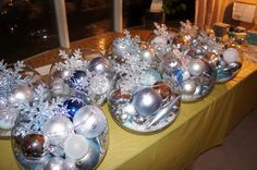 winter wedding centerpieces- bowls of ornaments topped with a snowflake