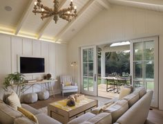 family room opens up to outdoor living/dining space